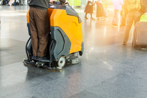 Professional ride along floor cleaning machine